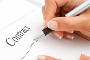 Publishing my first novel - signing the contract - extreme macro close up of female hand signing a contract - copyright Karel Joseph Noppe Brooks